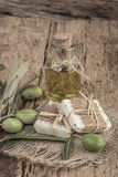 Natural olive oil soap bars and oil bottle on wooden table Royalty Free Stock Photography