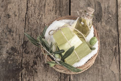 Natural olive oil soap bars and olive oil bottle in a basket Stock Photo