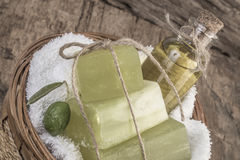 Natural olive oil soap bars and olive oil bottle in a basket Royalty Free Stock Photography