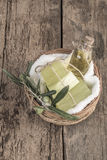 Natural olive oil soap bars and olive oil bottle in a basket Royalty Free Stock Image
