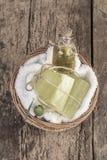Natural olive oil soap bars and olive oil bottle in a basket Stock Images