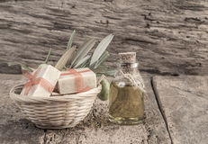 Natural olive oil soap bars and olive oil bottle on wooden table Stock Photo