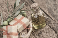 Natural olive oil soap bars and olive oil bottle on wooden table Stock Image