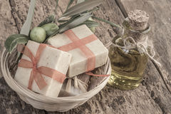 Natural olive oil soap bars and olive oil bottle on wooden table Royalty Free Stock Photo