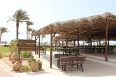 Natural open restaurant on the sea shore Royalty Free Stock Photos
