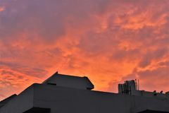 Natural orange sky before sunset. Orange sky before sunset and buildings Stock Photos
