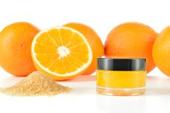 Natural orange sugar lip scrub on white. Stock Photo