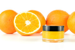 Natural orange sugar lip scrub on white. Royalty Free Stock Images