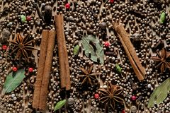 Natural organic aromatic spices are scattered on a wooden Board. Texture background with dry anise, cardamom, black and white stock photos