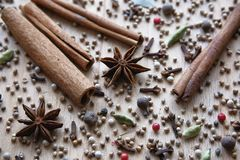 Natural organic aromatic spices are scattered on a wooden Board. Texture background with dry aromatic spices star anise, cardamom stock photos