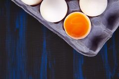 Natural organic chicken eggs. In cardboard package on blue background. Copy space. Top view. Flat lay Stock Photo