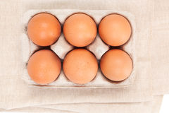 Natural organic chicken eggs, top view. Natural organic chicken eggs in cardboard package, top view. Natural healthy eating Stock Photography
