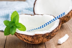Natural organic coconut water in cracked coconut Stock Photos
