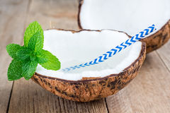 Natural organic coconut water in cracked coconut Royalty Free Stock Images