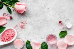 Natural organic cosmetics with rose oil. Cream, lotion, spa salt on grey background top view copyspace stock photo