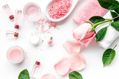 Natural organic cosmetics with rose oil. Cream, lotion, spa salt on white background top view Stock Photo