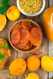 Natural organic dried apricots, apricot jam, and pollen Stock Photography