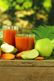 Natural organic fresh juice of carrots and green apple Stock Photos