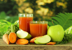 Natural organic fresh juice of carrots and green apple Stock Images