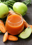 Natural organic fresh juice of carrots and green apple Royalty Free Stock Photography