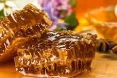 Natural organic honey  on a wooden table. closeup Stock Photos