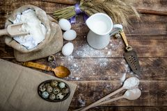 Natural organic ingredients to make cookies as dough, flour, eggs, butter,milk. On wooden background stock image