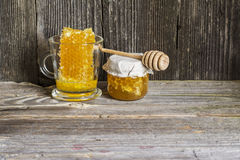 Natural organic lime honey in honeycombs with a private apiary on a textured wooden dark background in a horizontal Stock Image