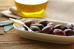 Natural organic olives in a white bowl Stock Photos