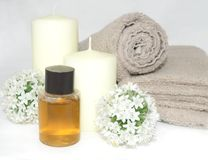 Natural Organic Spa. Natural still life of spa bathroom with relaxing candles, flowers, beige towels and lotions Stock Photography