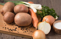 Natural organic vegetables on kitchen Board Stock Image