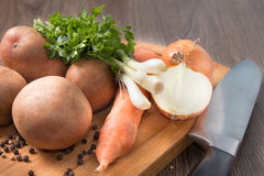 Natural organic vegetables on kitchen Board. Natural organic vegetables on a chopping board Royalty Free Stock Images
