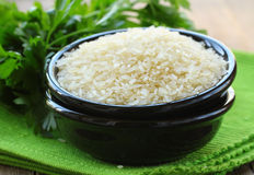 Natural organic white rice in bowl Stock Image