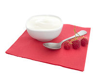 Natural organic yoghurt, yoghourt on red napkin with raspberries Royalty Free Stock Image
