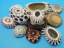Natural painted and crocheted stones Stock Photography