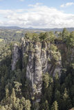 Natural Park Bastei. Saxony. Germany. Natural Park Bastei, Saxony, Germany - 7 september, 2015: Complex sandy cliffs, towering above the surface. Between the Royalty Free Stock Photos