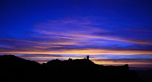Awesome sky at nightfall on natural park Roque Nublo,Gran canaria island. Sunset on Roque Nublo, Gran canaria, Canary islands Royalty Free Stock Images