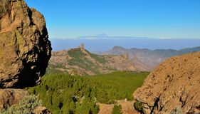 Natural park Roque Nublo and Tenerife island with blue sky background, from Gran canaria. Landscapes from the summit of Gran canaria Royalty Free Stock Photography