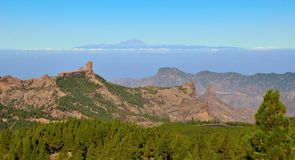Natural park Roque Nublo and Tenerife island with blue sky background, from Gran canaria. Landscapes from the summit of Gran canaria Stock Images