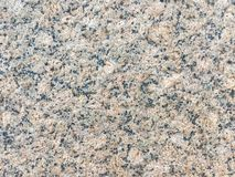 Natural pattern of granite stone texture. Black and pink spots o Royalty Free Stock Photography