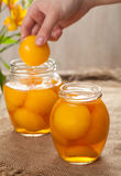 Natural peach compot in glass jars, healthy preserved dessert Royalty Free Stock Photography