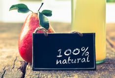 Natural pear juice on display stock photos