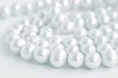 Natural pearl necklace on white, blue tinted Royalty Free Stock Photos
