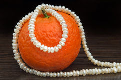 Natural Pearls Necklace and Mandarin Stock Photography