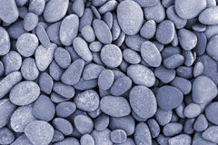 Natural pebble stone background Stock Photos