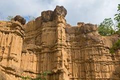 Natural phenomenon of eroded cliff, soil pillars, rock sculpture Stock Photography
