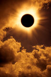 Natural phenomenon. Solar eclipse space with cloud on gold sky  Royalty Free Stock Photo
