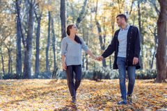 Natural photos of a happy couple in love having fun outside on a sunny autumn day. Togetherness and happiness concept stock image