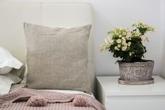 Natural pillow on bed in a cozy bedroom, Mockup.  royalty free stock image