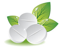 Natural pills with green leaves Stock Photography