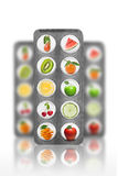 Natural pills with vitamins and fruits isolated Royalty Free Stock Photography